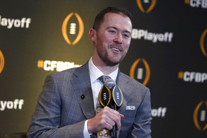 Oklahoma head coach Lincoln Riley speaks during a news conference ahead for the College Football playoffs Thursday, Dec. 12, 2019, in Atlanta. Ryan Day of Ohio State was unable to attend. (AP Photo/John Bazemore)