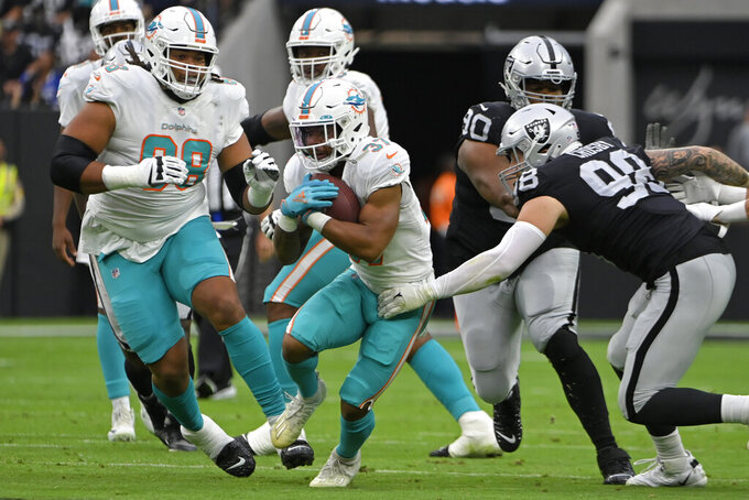 Miami Dolphins running back Myles Gaskin (37) runs against the Las Vegas Raiders during the first half of an NFL football game, Sunday, Sept. 26, 2021, in Las Vegas. (AP Photo/David Becker)