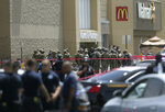 FILE - In this Aug. 3, 2019, file photo, several law enforcement agencies respond to an active shooter at a Walmart in El Paso, Texas. The suspect in the mass shooting was indicted Thursday, Sept. 12, 2019, for capital murder. Patrick Crusius, 21, of Allen, Texas, was indicted in connection with the Aug. 3 mass shooting that left 22 dead. He is jailed without bond. (Mark Lambie/The El Paso Times via AP, File)