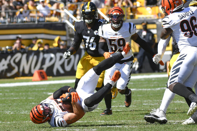 Cincinnati Bengals linebacker Logan Wilson (55) lands after making an interception of a pass by Pittsburgh Steelers quarterback Ben Roethlisberger during the first half an NFL football game, Sunday, Sept. 26, 2021, in Pittsburgh. (AP Photo/Don Wright)