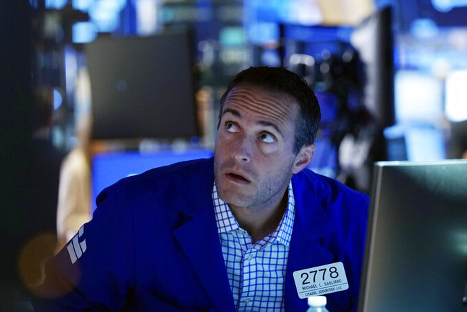 Specialist Michael Gagliano works at his post on the trading floor of the New York Stock Exchange, Tuesday, July 20, 2021. Stocks are opening higher on Wall Street Tuesday as investors shake off a rout a day earlier brought on by concerns about the spread of a more contagious variant of COVID-19. (AP Photo/Richard Drew)