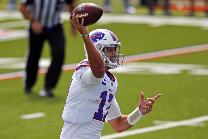 Buffalo Bills quarterback Josh Allen (17) throws a touchdown pass to running back Zack Moss during the first half of an NFL football game against the New York Jets in Orchard Park, N.Y., Sunday, Sept. 13, 2020. (AP Photo/John Munson)