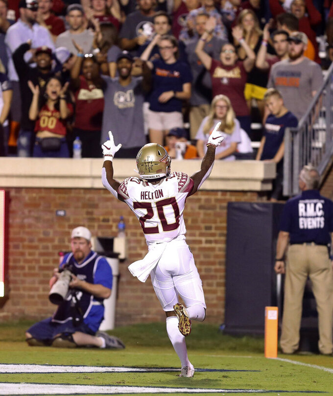Florida State wide receiver Keyshawn Helton (20) celebrates a touchdown during the second half of an NCAA college football game against Virginia in Charlottesville, Va., Saturday, Sept. 14, 2019. (AP Photo/Andrew Shurtleff)