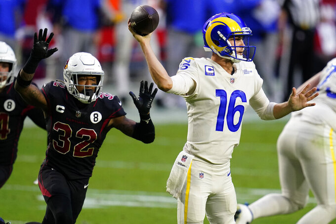 Los Angeles Rams quarterback Jared Goff (16) throws as Arizona Cardinals strong safety Budda Baker (32) defends during the second half of an NFL football game, Sunday, Dec. 6, 2020, in Glendale, Ariz. (AP Photo/Ross D. Franklin)