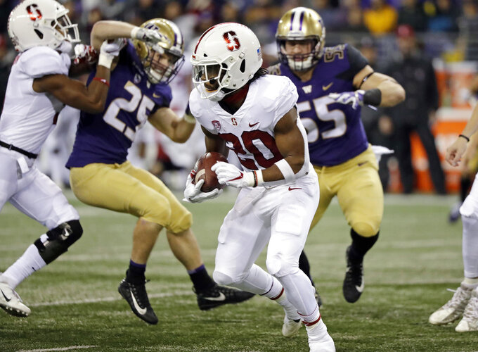 Stanford's Bryce Love carries during the first half of the team's NCAA college football game against Washington on Saturday, Nov. 3, 2018, in Seattle. (AP Photo/Elaine Thompson)