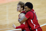 Texas Tech guard Mac McClung (0) is grabbed by guard Kyler Edwards (11) as they celebrate McClug's winning basket in the final seconds of an NCAA college basketball game against Texas, Wednesday, Jan. 13, 2021, in Austin, Texas. Texas Tech won 79-77. (AP Photo/Eric Gay)