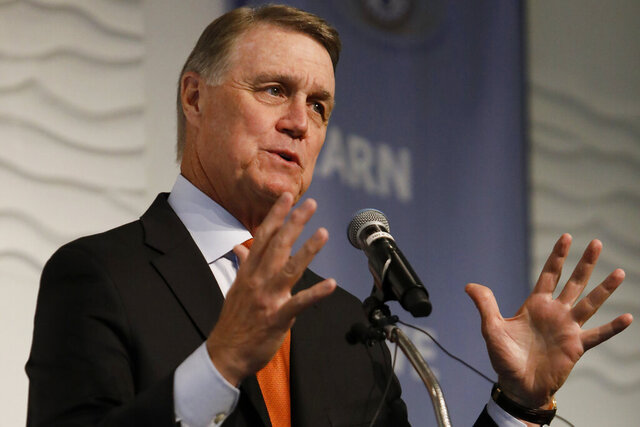 FILE - In this Aug. 6, 2019, file photo, Sen. David Perdue, R-Ga., speaks during a Kiwanis Club of Atlanta luncheon. Republican Sen. David Perdue of Georgia is set to face Democrat Jon Ossoff in the first debate of their U.S. Senate race Monday afternoon, Oct. 12, 2020. (AP Photo/Andrea Smith, File)