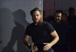 Jock Palfreeman reacts as he leaves migrants' detention centre in Busmantsi, Bulgaria, Tuesday, Oct. 15, 2019. Australian man Palfreeman was convicted of fatally stabbing a Bulgarian student during a 2007 brawl and has been paroled after serving 11-years of his 20-year prison sentence, but then held back in a detention centre after a prosecutors' petition to revoke the parole. (AP Photo)