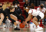 Virginia Tech's Elizabeth Kitley (33) and North Carolina State's Kai Crutchfield (3), right, go after the loose ball during the first half of an NCAA college basketball game, Sunday, Jan. 24, 2021 in Raleigh, N.C. (Ethan Hyman/The News & Observer via AP)