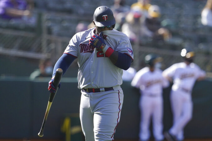 Minnesota Twins' Miguel Sano walks to the dugout after striking out against the Oakland Athletics during the fourth inning of the first baseball game of a doubleheader in Oakland, Calif., Tuesday, April 20, 2021. (AP Photo/Jeff Chiu)