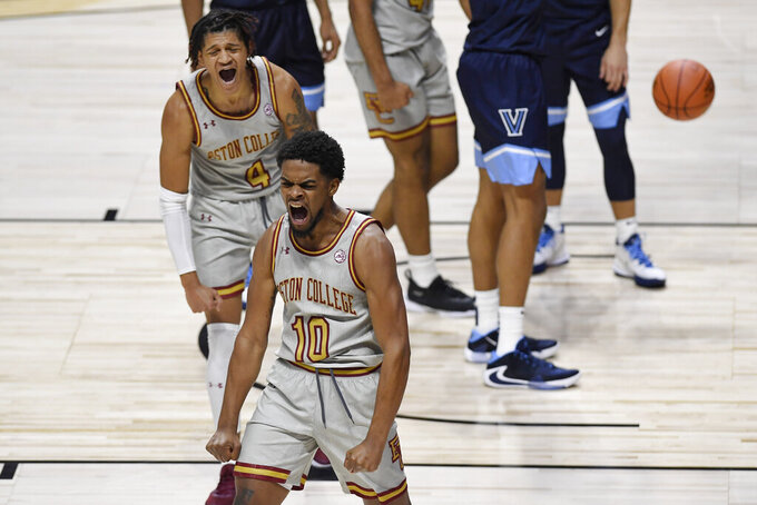 Boston College's Wynston Tabbs (10) and Makai Ashton-Langford (4) react during the second half of the team's NCAA college basketball game against Villanova, Wednesday, Nov. 25, 2020, in Uncasville, Conn. (AP Photo/Jessica Hill)