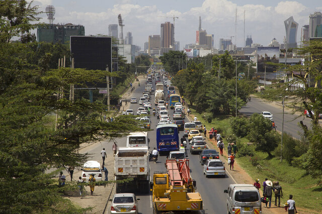 In this photo taken Thursday, Feb. 13, 2020, traffic sits queued up on Uhuru Highway leading to downtown Nairobi, Kenya. In many parts of sub-Saharan Africa new wheels often mean a used car from Japan or Europe which are affordable to the growing middle class, but environmental activists and others complain that the second-hand vehicles, unable to meet stringent pollution tests elsewhere, are simply being dumped in the world's poorest continent. (AP Photo/Sayyid Abdul Azim)