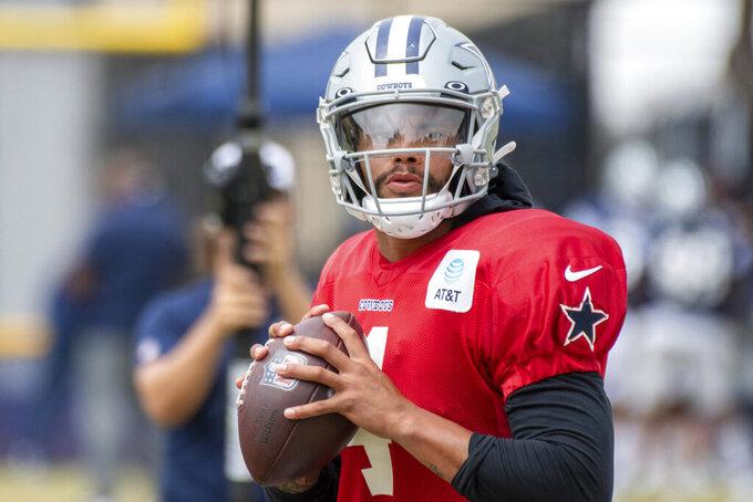 Dallas Cowboys quarterback Dak Prescott does a non-passing drill during practice at the NFL football team's training camp in Oxnard, Calif., Saturday, July 31, 2021. (AP Photo/Michael Owen Baker)