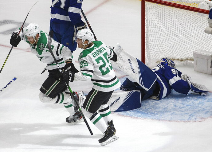 Dallas Stars right wing Corey Perry (10) celebrates his goal against Tampa Bay Lightning goaltender Andrei Vasilevskiy (88) with Joel Kiviranta (25) during the second overtime in Game 5 of the NHL hockey Stanley Cup Final, Saturday, Sept. 26, 2020, in Edmonton, Alberta. (Jason Franson/The Canadian Press via AP)