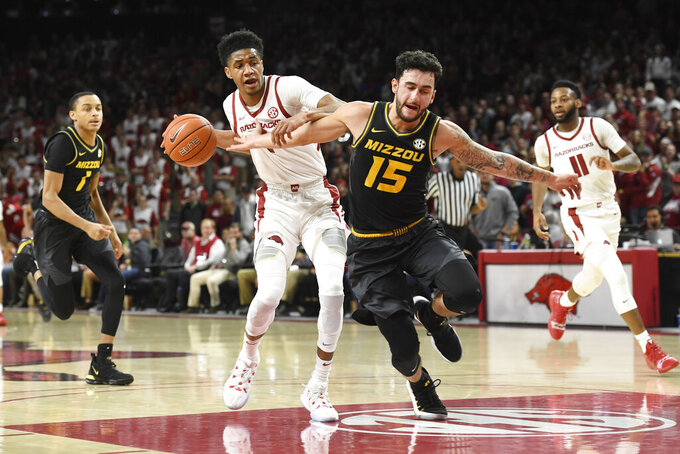 Arkansas guard Isaiah Joe (1) steals the ball and tries to drive past Missouri guard Jordan Geist (15) during the first half of an NCAA college basketball game, Wednesday, Jan. 23, 2019 in Fayetteville, Ark. (AP Photo/Michael Woods)