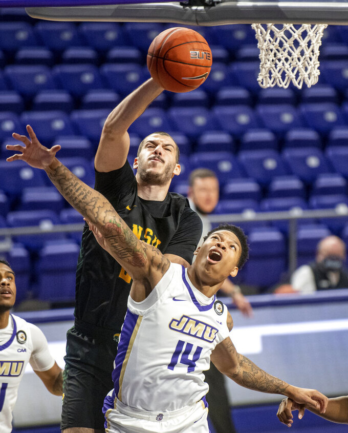 Norfolk State forward Efstratios Kalogerias (23) grabs a rebound over James Madison guard Jayvis Harvey (14) during the first half of an NCAA basketball game in Harrisonburg, Va., Friday, Nov. 27, 2020. (Daniel Lin/Daily News-Record via AP)