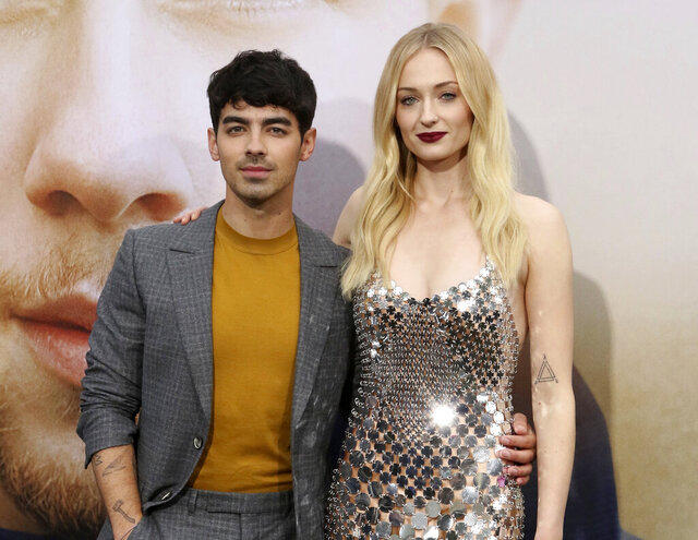 FILE - Joe Jonas, left, and Sophie Turner attend the World Premiere of
