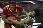 Iowa State forward Solomon Young, left, grabs a rebound against Oklahoma guard Elijah Harkless, right, during the first half of an NCAA college basketball game in the first round of the Big 12 men's tournament in Kansas City, Mo., Wednesday, March 10, 2021. (AP Photo/Orlin Wagner)