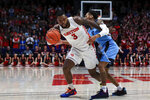 Dayton's Trey Landers controls the ball as he is fouled by Rhode Island's Fatts Russell during the second half of an NCAA college basketball game, Tuesday, Feb. 11, 2020, in Dayton, Ohio. Dayton won 81-67. (AP Photo/Aaron Doster)