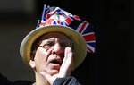 A pro-Brexit demonstrator shouts near Parliament in London, Wednesday, April 10, 2019.  Just days away from a no-deal Brexit, European Union leaders meet Wednesday to discuss granting the United Kingdom a new delay to its departure from the bloc. (AP Photo/Kirsty Wigglesworth)