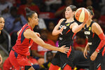 Las Vegas Aces guard Kelsey Plum, right, looks to pass the ball as Washington Mystics guard Natasha Cloud, left, defends during the first half of Game 1 of a WNBA playoff basketball series Tuesday, Sept. 17, 2019, in Washington. (AP Photo/Nick Wass)