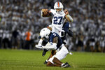 Auburn running back Jarquez Hunter (27) hurdles Penn State cornerback Joey Porter Jr. (9) during the fourth quarter of an NCAA college football game in State College, Pa., Saturday, Sept. 18, 2021.Penn State won 28-20. (AP Photo/Barry Reeger)