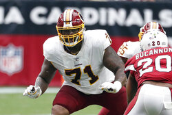 FILE - In this Sept. 9, 2018, file photo, Washington Redskins offensive tackle Trent Williams (71) is shown in action during an NFL football game against the Arizona Cardinals, in Glendale, Ariz. Fans worry that the summer rite in the NFL, training camp holdouts, won't affect their team's chances for a championship. This year's crop of no-shows includes an All-Pro receiver, the Saints' Michael Thomas; a standout offensive tackle who might be the key to the Redskins' offense, Trent Williams; and budding stars DEs Jadeveon Clowney of the Texans, Yannick Ngakoue of the Jaguars, and RB Melvin Gordon of the Chargers. (AP Photo/Rick Scuteri, File)