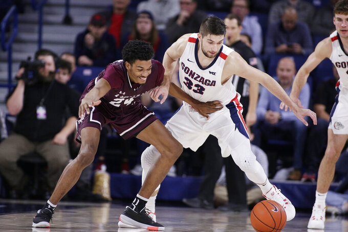 Texas Southern forward John Walker III (24) and Gonzaga forward Killian Tillie (33) go after the ball during the second half of an NCAA college basketball game in Spokane, Wash., Wednesday, Dec. 4, 2019. Gonzaga won 101-62. (AP Photo/Young Kwak)