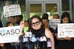 Mony Ruiz-Velasco, director of PASO West Suburban Action Project, addresses reporters during a new conference outside the U.S. Citizenship and Immigration Services offices in Chicago, Thursday, July 11, 2019.  A nationwide immigration enforcement operation targeting people who are in the United States illegally is expected to begin this weekend (AP Photo/Amr Alfiky)