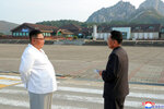 In this undated photo provided on Wednesday, Oct. 23, 2019, by the North Korean government, North Korean leader Kim Jong Un, left, visits the Diamond Mountain resort in Kumgang, North Korea. Kim ordered the destruction of South Korean-made hotels and other tourist facilities at the North's Diamond Mountain resort, apparently because Seoul won't defy international sanctions and resume South Korean tours at the site, Pyongyang's official Korean Central News Agency said Wednesday. Independent journalists were not given access to cover the event depicted in this image distributed by the North Korean government. The content of this image is as provided and cannot be independently verified. Korean language watermark on image as provided by source reads: