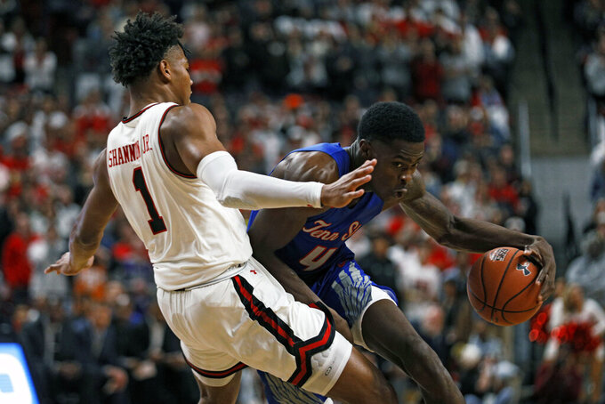 Tennessee State's Wesley Harris (4) knocks down Texas Tech's Terrence Shannon Jr. (1) while driving the ball to the basket during the first half of an NCAA college basketball game Thursday, Nov. 21, 2019, in Lubbock, Texas. (AP Photo/Brad Tollefson)