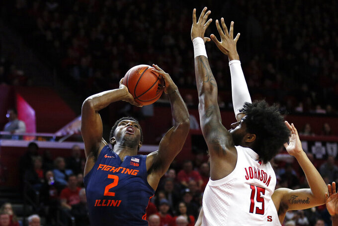 Illinois forward Kipper Nichols (2) shoots past Rutgers center Myles Johnson (15) during the first half of an NCAA college basketball game Saturday, Feb. 15, 2020, in Piscataway, N.J. (AP Photo/Adam Hunger)