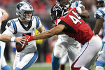 Atlanta Falcons defensive end Vic Beasley (44) causes Carolina Panthers quarterback Kyle Allen (7) to fumble during the second half of an NFL football game, Sunday, Dec. 8, 2019, in Atlanta. (AP Photo/Danny Karnik)