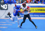 San Diego State wide receiver Fred Trevillion (7) tries to separate from Boise State safety Kekoa Nawahine (10) after a reception in the first half of an NCAA college football game, Saturday, Oct. 6, 2018, in Boise, Idaho. (AP Photo/Steve Conner)