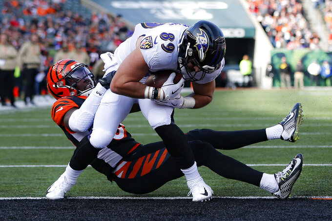 Baltimore Ravens tight end Mark Andrews (89) scores a touchdown against Cincinnati Bengals linebacker LaRoy Reynolds, left, during the first half of NFL football game, Sunday, Nov. 10, 2019, in Cincinnati. (AP Photo/Frank Victores)