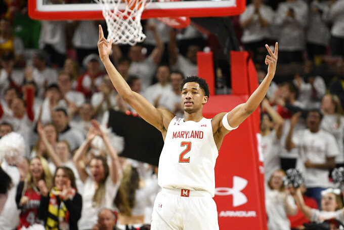 Maryland guard Aaron Wiggins (2) reacts after he made a three-point basket during the second half of an NCAA college basketball game against Michigan, Sunday, March 8, 2020, in College Park, Md. (AP Photo/Nick Wass)