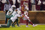 Oklahoma wide receiver Jadon Haselwood (11) is tackled by Baylor cornerback Raleigh Texada (3) during the second half of an NCAA college football game Saturday, Dec. 5, 2020, in Norman, Okla. (AP Photo/Sue Ogrocki)