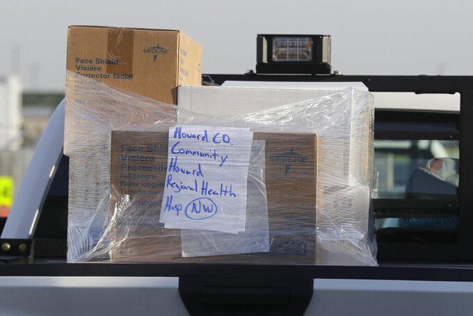 A pallet of medical supplies is seen in the back of a pickup truck, Thursday, March 26, 2020, in Indianapolis. The medical supplies, which were being delivered by the Indiana State Police and INDOT, were going to Indiana hospitals and health departments to help fight the coronavirus pandemic.  The new coronavirus causes mild or moderate symptoms for most people, but for some, especially older adults and people with existing health problems, it can cause more severe illness or death. (AP Photo/Darron Cummings)
