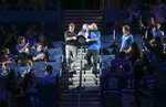 The Stanley Cup is carried down to the ice at Amalie Arena as fans look on Tuesday, Sept. 29, 2020, in Tampa, Fla. (Dirk Shadd/Tampa Bay Times via AP)