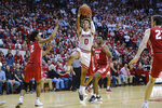 Indiana guard Romeo Langford (0) shoots in front of Wisconsin guard Khalil Iverson (21) during the second half of an NCAA college basketball game in Bloomington, Ind., Tuesday, Feb. 26, 2019. Indiana won 75-73 in double overtime. (AP Photo/AJ Mast)