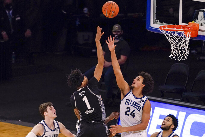 Georgetown forward Jamorko Pickett (1) goes to the basket over Villanova forward Jeremiah Robinson-Earl (24) during the second half of an NCAA college basketball game in the quarterfinals of the Big East conference tournament, Thursday, March 11, 2021, in New York. Georgetown won 72-71. (AP Photo/Mary Altaffer)