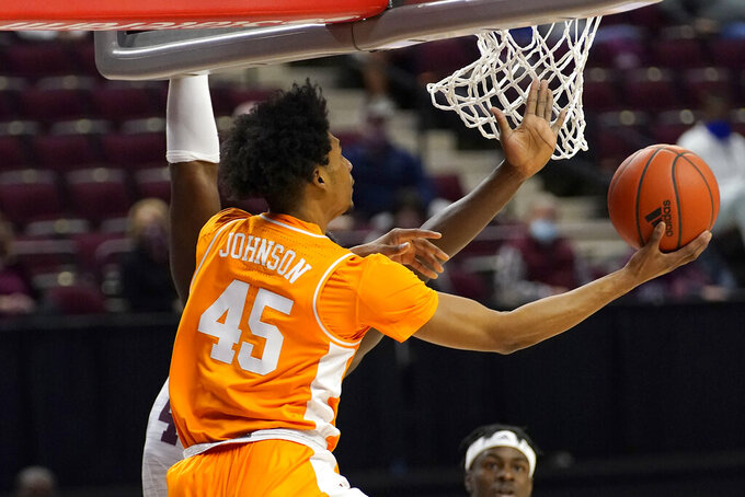 Tennessee guard Keon Johnson (45) makes a basket around a Texas A&M defender during the first half of an NCAA college basketball game Saturday, Jan. 9, 2021, in College Station, Texas. (AP Photo/Sam Craft)