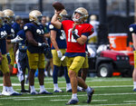 Quarterback Tyler Buchner throws during Notre Dame NCAA college football practice in South Bend, Ind., Thursday, Aug. 12, 2021. (Michael Caterina/South Bend Tribune via AP)