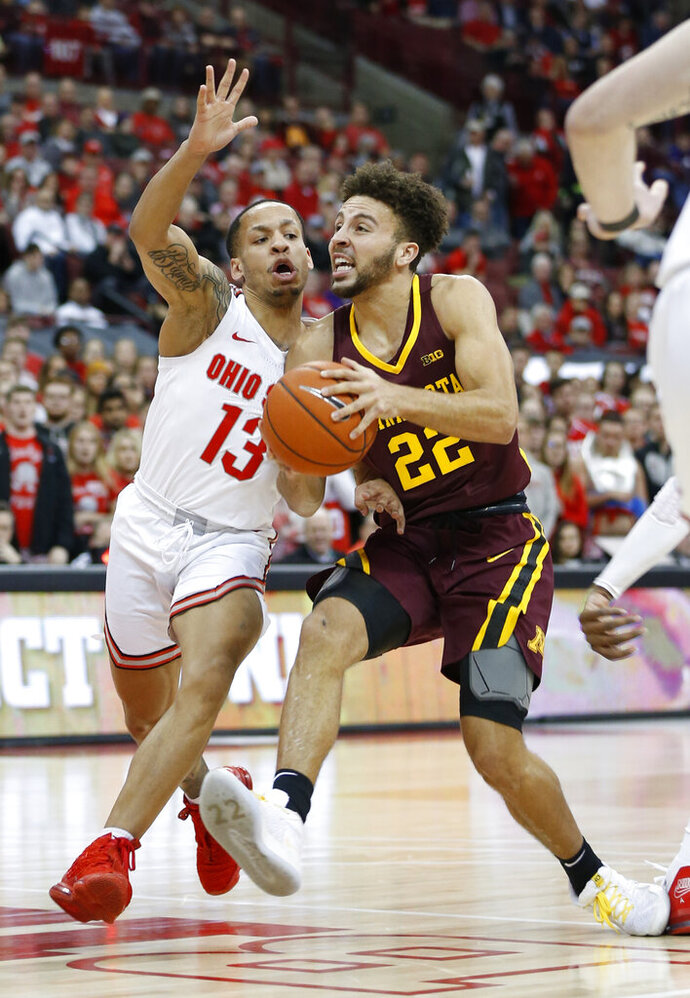 Minnesota's Gabe Kalscheur, right, tries to dribble past Ohio State's C.J. Walker during the first half of an NCAA college basketball game Thursday, Jan. 23, 2020, in Columbus, Ohio. (AP Photo/Jay LaPrete)