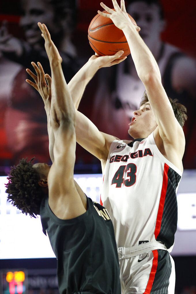 Georgia guard Ignas Sargiunas (43) takes a shot while being defended by Vanderbilt guard Saben Lee (0) during an NCAA college basketball game, Wednesday, Jan. 9, 2019 in Athens, Ga. (Joshua L. Jones/Athens Banner-Herald via AP)