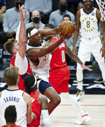 Indiana Pacers center Myles Turner, right, shoots in front of Portland Trail Blazers center Jusuf Nurkic during the first half of an NBA basketball game in Portland, Ore., Thursday, Jan. 14, 2021. (AP Photo/Craig Mitchelldyer)