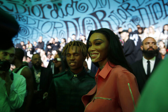 Model Winnie Harlow poses for a photograph before the Christian Dior pre-fall 2020 men's fashion collection presentation during Art Basel on Tuesday, Dec. 3, 2019, in Miami. (AP Photo/Brynn Anderson)