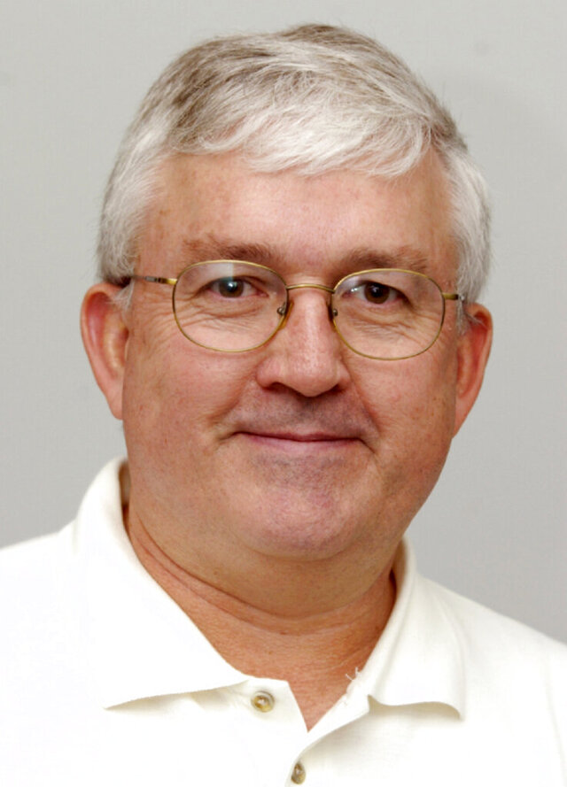 This Oct. 8, 2006 photo shows Tom Vint, who covered the dominant Nebraska football teams of the 1980s and '90s as an Associated Press sports writer. Vint died Wednesday, Sept. 2, 2020, after a monthlong battle with COVID-19, his daughter Mandy Troia said. He was 72. Vint retired from the AP after 25 years working in multiple roles in the Omaha bureau.  (AP Photo/Nati Harnik)