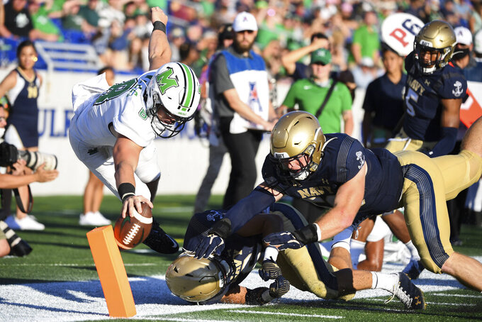 Marshall quarterback Grant Wells (8) runs the ball and is knocked out of bounds at the one yard line during the second half of an NCAA college football game against Navy, Saturday, Sept. 4, 2021, Annapolis, Md. (AP Photo/Terrance Williams)