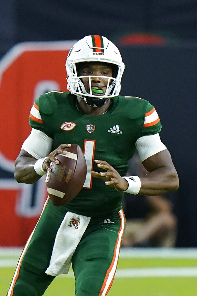 Miami quarterback D'Eriq King looks for an open teammate during the first half of an NCAA college football game against Appalachian State, Saturday, Sept. 11, 2021, in Miami Gardens, Fla. (AP Photo/Wilfredo Lee)